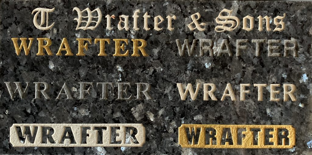 Examples of raised inscriptions produced by T. Wrafter & Sons, stone masons in Brisbane.